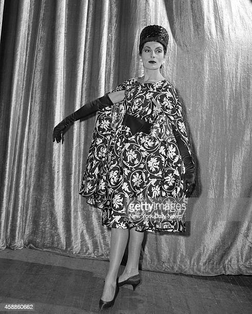 Fashion Show at Waldorf Chemise slip with poncho swathes Jackie Rogers who's modeling a blackandwhite number from TrainaNorell Anthony Traina and...