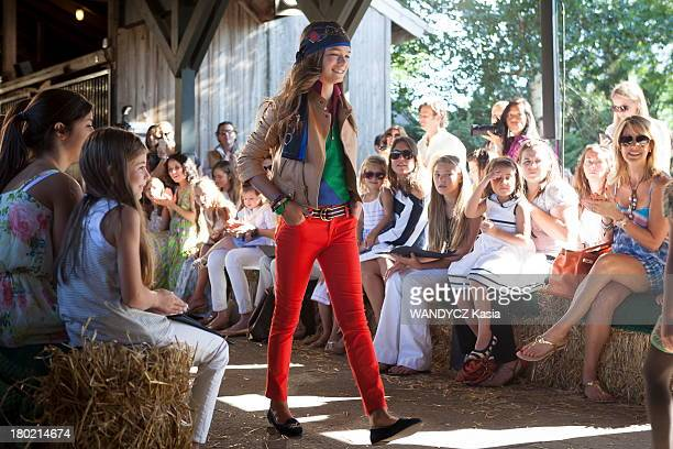 A fashion show for Ralph Lauren Kids in a barn in Southampton on August 2013 in the HamptonsNY