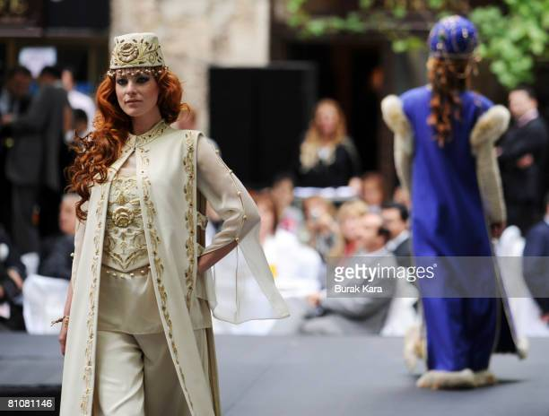 A fashion show is performed at a silk market in the presence of Britain's Queen Elizabeth II in Turkey's northwest city of Bursa on May 14 2008 in...