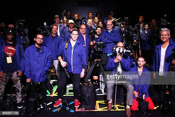 Fashion show photographers pay tribute to Bill Cunningham by wearing his signature blue jacket look to kick off New York Fashion Week The Shows...