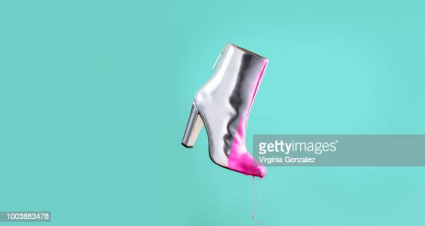 fashion silver boots - metallic boot stock pictures, royalty-free photos & images