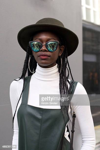 Fashion student Abiola Renee wears Zara dress Quay sunglasses and Forever 21 hat on day 2 during London Fashion Week Spring/Summer 2016/17 on...