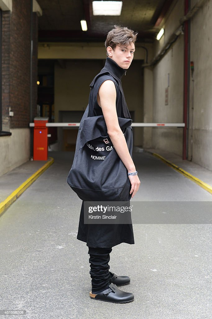 Fashion student and designer for After Homework Peter Kaczmarek wearing Comme Des Garcons skirt and bag, Rick Owen vest, Margiella scarf, After Homework semi-pants and Birkenstock sandals on day 1 of Paris Collections: Men on June 25, 2014 in Paris, France.