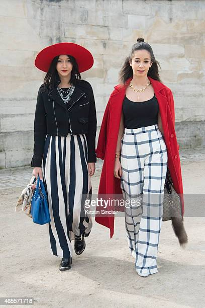 Fashion student Carla Leal wears Lack of Colour Hat Sixth June coat Vintage skirt and Jeffrey Campbell shoes With Fashion blogger Lena Mahfouf wears...