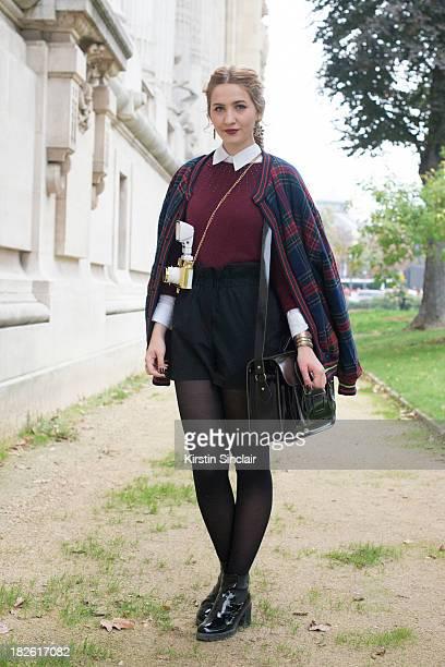 Fashion student Elisa Baudoin wears vintage jacket Asos shorts Vagabond shoes H and M jumper and Cambridge Satchel Co bag on day 8 of Paris Fashion...
