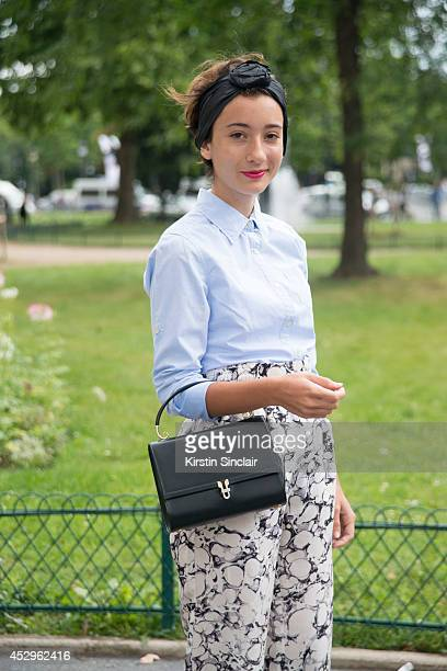 Fashion Student Elisa Carassai wearing a vintage bag Wood Wood trousers vinatge bag a handmade headband and Maison Scotch top day 3 of Paris Haute...