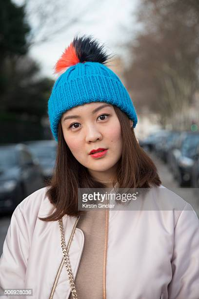 Fashion student Jaime Lo wears a Acne Studio jacket and Topshop hat on day 2 of Paris Haute Couture Fashion Week Spring/Summer 2016 on January 25...