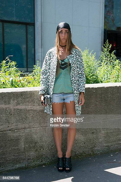 Fashion Student Louise Laveugne wears a Victoria Secret top Diesel shorts Moschino jacket Vanessa Bruno bag and Jimmy Choo shoes on day 2 of Paris...
