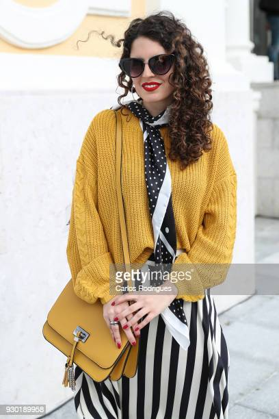 Fashion Student Margarida Sousa wearing glasses from Primark Skirt scarf and sweater from Stradivarius bag from Zara during the 50 edition of Lisboa...