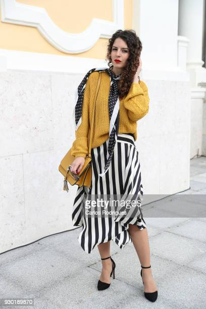 Fashion Student Margarida Sousa wearing skirt scarf and sweater from Stradivarius bag from Zara during the 50 edition of Lisboa Fashion Week...
