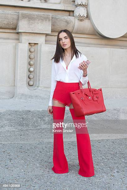 Fashion Student Mariana Moldovan wears a Ralph Lauren bag Cristina Savulescu trousers and a H and M top on day 3 during Paris Fashion Week...