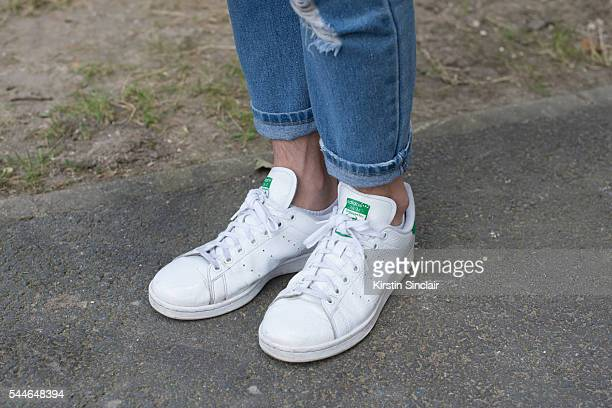 Fashion Student Wang wearing Stan Smith for Adidas trianers and Indendent Creator jeans on day 4 of Paris Collections Men on June 25 2016 in Paris...