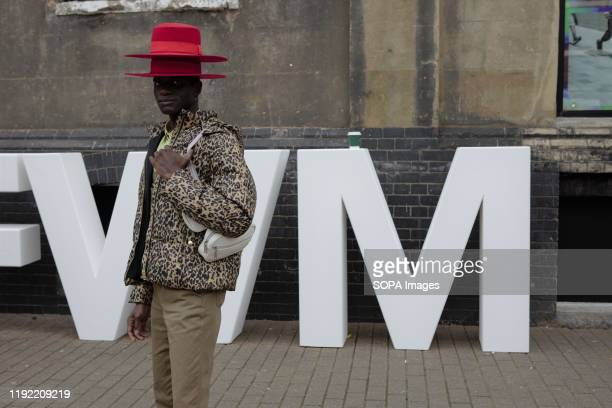 Fashion stylist Abdel Keita Tavares, from Guinea-Bissau the Man Behind the Red Hat attends the London Fashion Week Men's Day two Street Style.