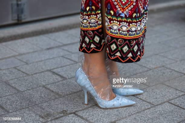 Fashion stylist Ada Kokosar wears Midnight Zero Zero shoes and a Retromania skirt during London Fashion Week September 2018 on September 17 2018 in...
