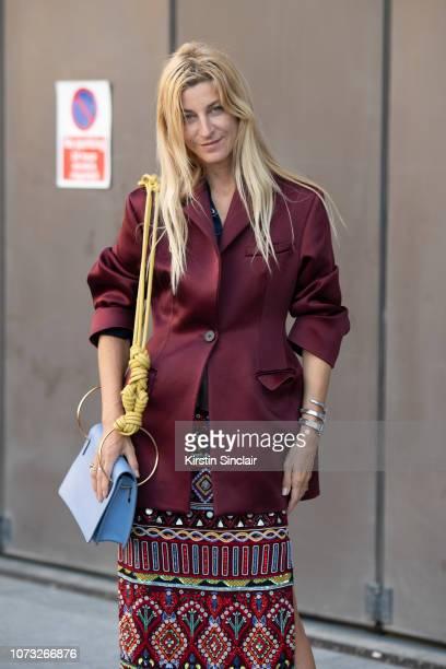 Fashion stylist Ada Kokosar wears Roksanda ilincic jacket and bag Retromania skirt during London Fashion Week September 2018 on September 17 2018 in...