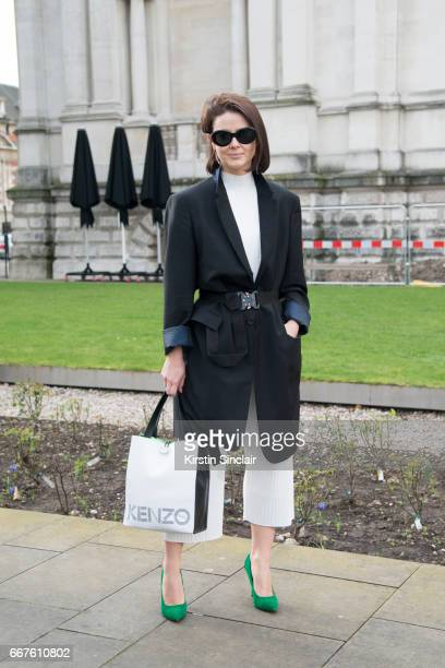 Fashion stylist Aga Kaczorewka wears a Jil Sander jacket, ALYX belt, Kenzo bag and Acne sunglasses on day 4 of London Womens Fashion Week...