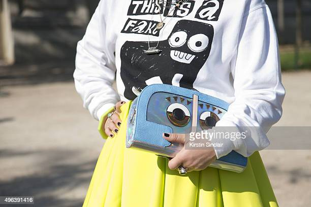Fashion Stylist Amanda Van Effrink wears Fendi sunglasses Bas Kosters top H and M skirt and Asos bag on day 5 during Paris Fashion Week Spring/Summer...