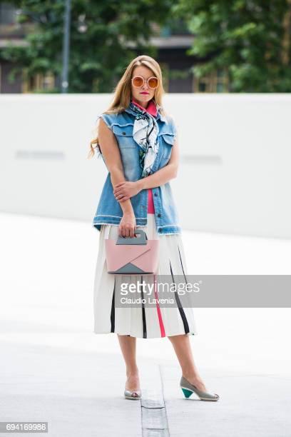 Fashion stylist and blogger Angelina Lepper wears a Denim Sveta gilet Mila Schon skirt and tshirt Mantero foulard Sunday Somewhere sunglasses CC...