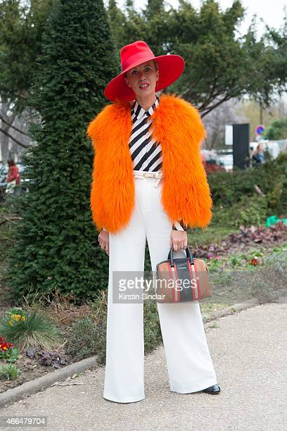 Fashion stylist and blogger Denisa Palsha wears a vintage jacket ASOS trousers French Connection shirt Lola hat Givenchy bag and Valentino shoes on...