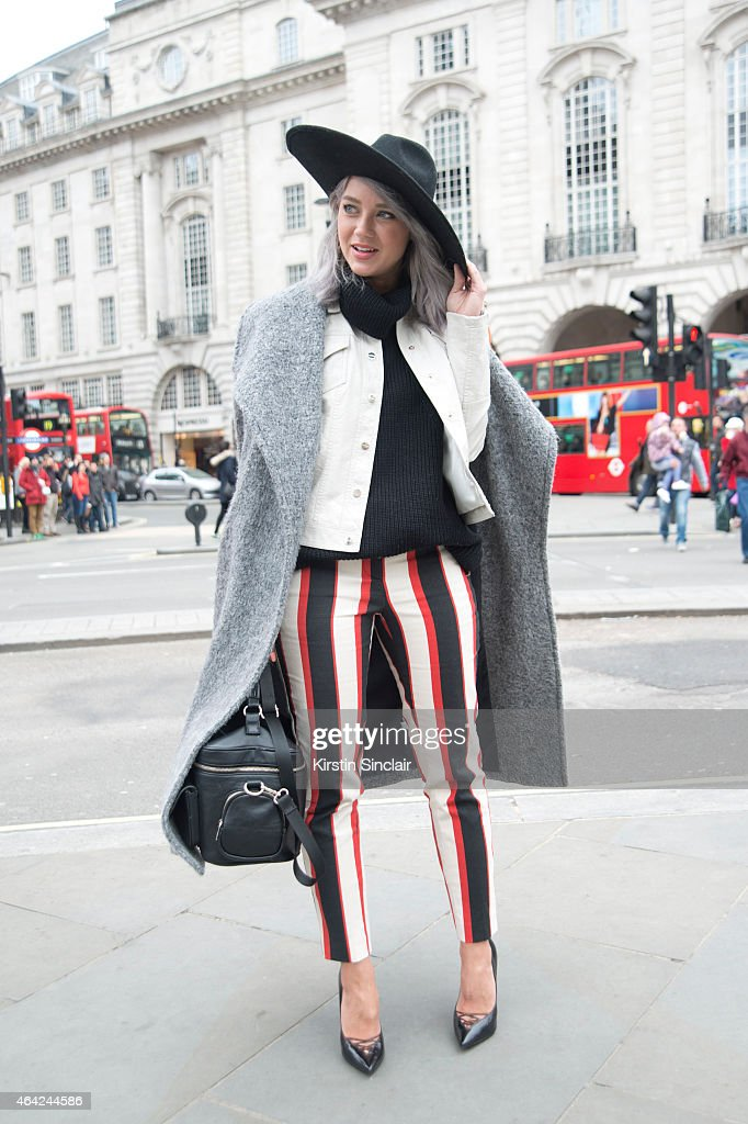 Fashion Stylist and Blogger Madelene Billman wears all River Island with her own design of bag on day 3 of London Collections: Women on February 22, 2015 in London, England.