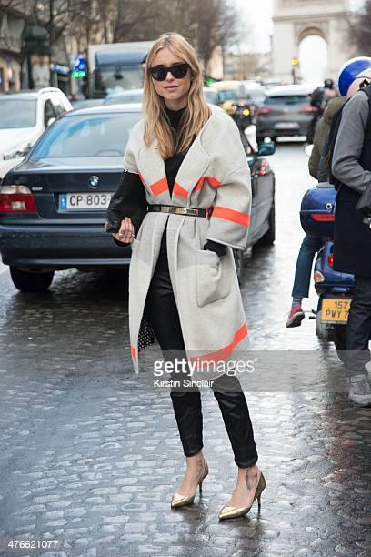 Fashion stylist and blogger Pernille Teisbaek wears Baum und Pferdgarten coat Isabel Marrant trousers Balenciaga bag Acne glasses on day 4 of Paris...