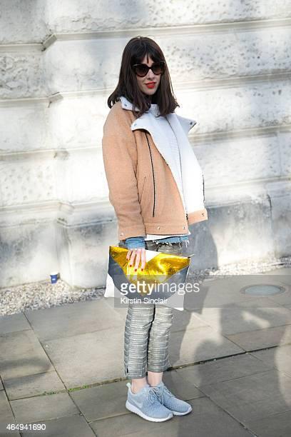 Fashion Stylist and Brand Consultant Natalia Feruiu wears Prada sunglasses Bimba Y Lola bag Kling jacket Nike shoes Mango trousers and Cos sweater on...