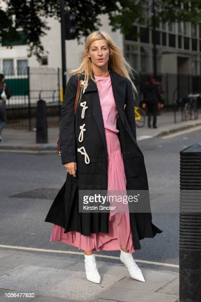 Fashion stylist and consultant Ada Kokosar wears a JW Anderson bag and coat Cesare Paciotti boots Ter et Batine skirt and Tome top during London...
