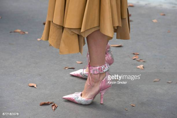 Fashion stylist and consultant Ada Kokosar wears a Loewe dress and Cesare Paciotti shoes day 4 of Paris Womens Fashion Week Spring/Summer 2018 on...