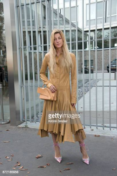 Fashion stylist and consultant Ada Kokosar wears a Loewe dress Cesare Paciotti shoes and a Delpozo bag day 4 of Paris Womens Fashion Week...