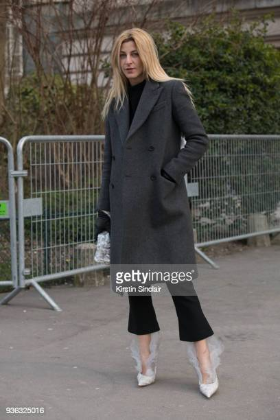 Fashion stylist and consultant Ada Kokosar wears Midnight oo shoes day 3 of Paris Womens Fashion Week Spring/Summer 2018 on February 28 2018 in...