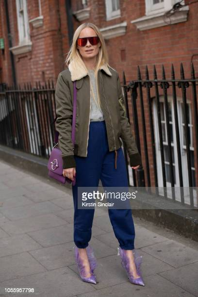 Fashion Stylist and creative consultant Thora Valdimars wears a JW Anderson jacket and bag Balenciaga trousers Mykita sunglasses and Midnight00 by...