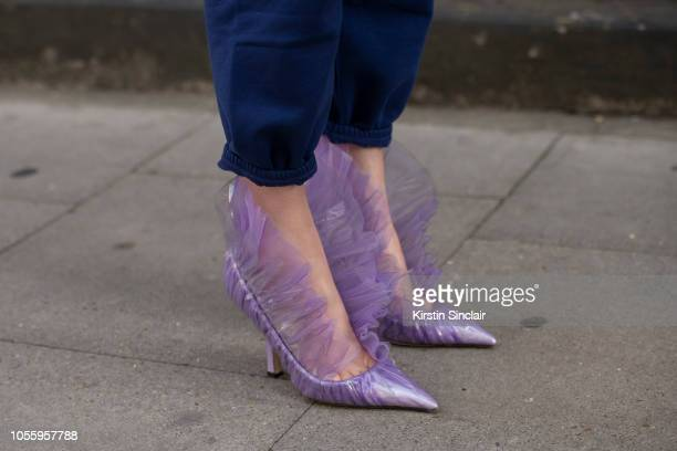Fashion Stylist and creative consultant Thora Valdimars wears Balenciaga trousers and Midnight00 by Ada Kokosar shoes during London Fashion Week...