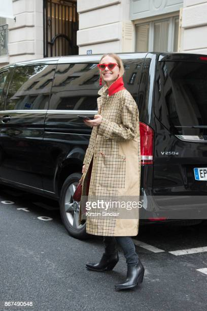 Fashion stylist and Creative director at Social Zoo Pernille Teisbaek wears a Celine jacket and boots day 3 of Paris Womens Fashion Week...