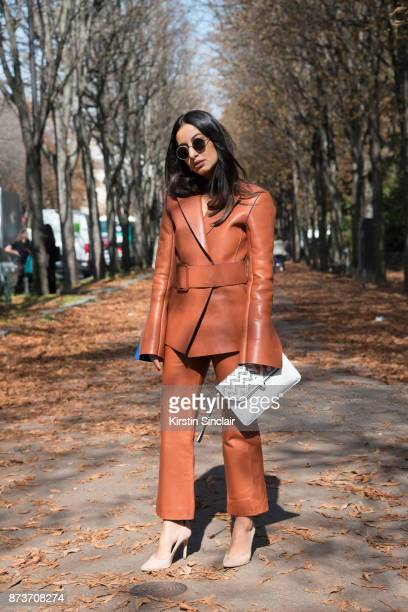 Fashion stylist and creative director Nausheen Shah wears an OffWhite suit Gianvito Rossi shoes Bulgari x Nicholas Kirkwood bag and Monica Sardo...