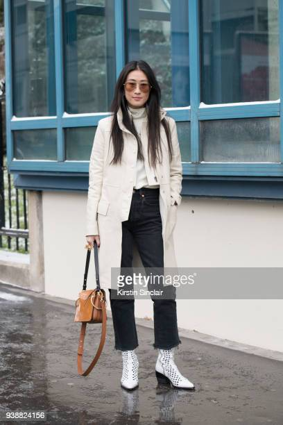 Fashion Stylist and director at Hong Kong Tatler Justine Lee wears a Chloé coat bag and boots Redone jeans and Linda Farrow sunglasses day 4 of Paris...