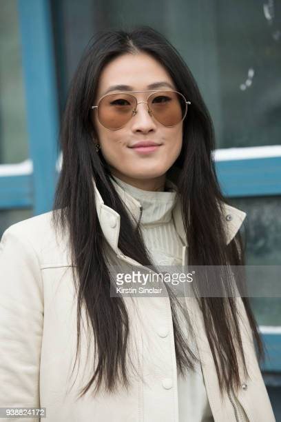 Fashion Stylist and director at Hong Kong Tatler Justine Lee wears a Chloé coat and Linda Farrow sunglasses day 4 of Paris Womens Fashion Week...