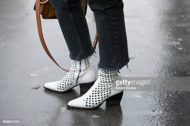 Fashion Stylist and director at Hong Kong Tatler Justine Lee wears a Chloé boots and Redone jeans day 4 of Paris Womens Fashion Week Spring/Summer...