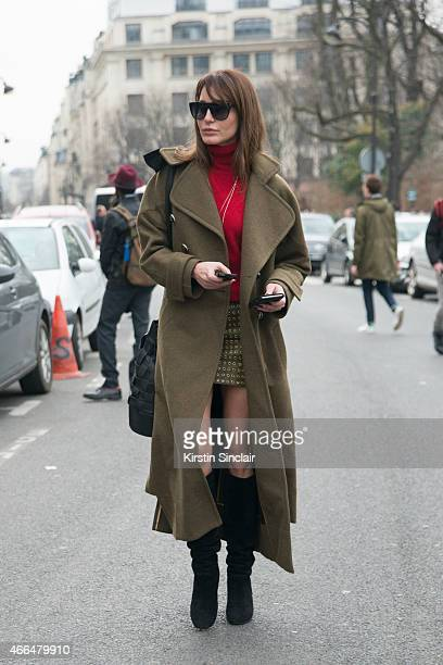 Fashion stylist and fashion consultant Ece Sukan wears a Barbara Bui coat vintage top Hot Couture skirt Lanvin boots Saint Laurent sunglasses...