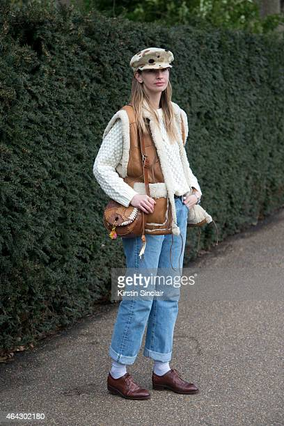 Fashion stylist and model Clara wears Levis jeans H and M sweater and vintage hat gilet bag and shoes on February 23 2015 in London England