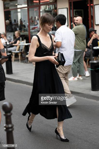 Fashion Stylist Anya Ziourova wears a Jason Wu dress and Manolo Blahnik shoes during Haute Couture Fall Winter 2018/2019 on July 1 2018 in Paris...