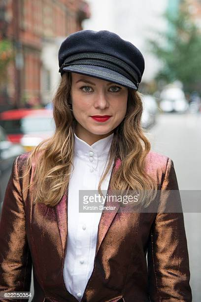 Fashion Stylist Beth Buxton wears a Sorapol suit and shirt and a vintage hat day 4 of London Womens Fashion Week Spring/Summer 2016 on September 19...