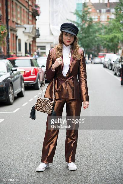 Fashion Stylist Beth Buxton wears a Sorapol suit and shirt vintage hat Christian Louboutin bag and Converse trainers day 4 of London Womens Fashion...