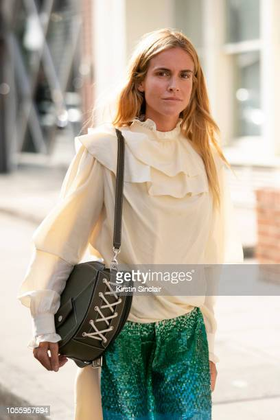 Fashion Stylist Blanca Miró Scrimieri wears JW Anderson dress and bag during London Fashion Week September 2018 on September 15 2018 in London England