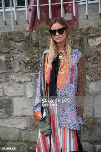 Fashion stylist Blanca Miro Scrimieri wears a Loewe coat and skirt and Saint Laurent sunglasses day 4 of Paris Womens Fashion Week Spring/Summer 2018...