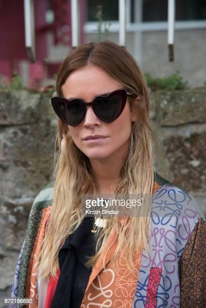 Fashion stylist Blanca Miro Scrimieri wears a Loewe coat Saint Laurent sunglasses day 4 of Paris Womens Fashion Week Spring/Summer 2018 on September...