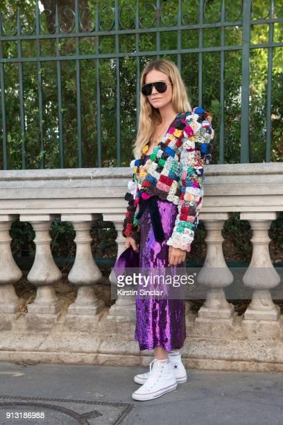 Fashion Stylist Blanca Miro Scrimieri wears a Nina Ricci skirt and bag Ronald Van Der Kemp jacket Dior sunglasses and Converse trainers day 4 of...