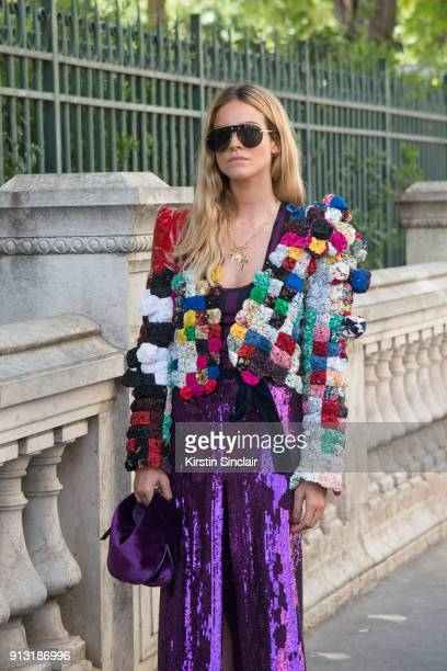 Fashion Stylist Blanca Miro Scrimieri wears a Nina Ricci skirt and bag Ronald Van Der Kemp jacket Dior sunglasses day 4 of Paris Haute Couture...