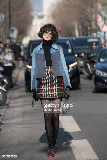 Fashion stylist Chloe Hill wears Gucci tights Miu Miu skirt Jerome Dreyfuss bag Mih Jeans jacket day 3 of Paris Womens Fashion Week Spring/Summer...