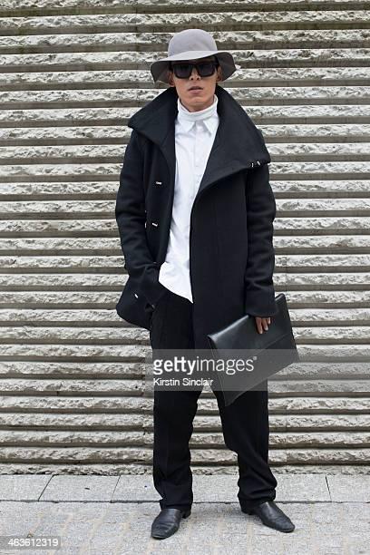 Fashion stylist Coke Ho wears a Yoham coat Raf Simons shirt Rick Owens trousers and bag Saint Laurent boots Karen Walker sunglasses and an H and M...