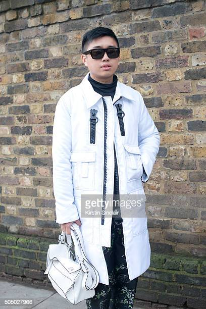 Fashion stylist Declan Chen wears a KTZ coat Nasir Mazhar top Astrid Anderson trousers and a Loewe bag on day 4 of London Collections Men on Januay...